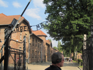 "The gates into Auschwitz Concentration Camp reads ""Arbeit macht frei"", a German phrase meaning works makes (you) free."