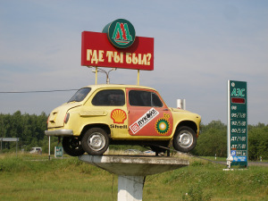 "A Russian fuel station. The billboard asks ""Where have you been?""."